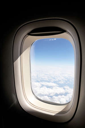 airplane window: cloudscape of window at flying airplane Stock Photo