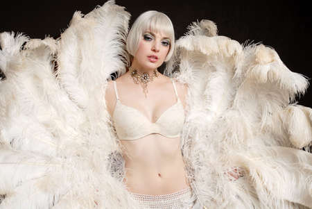 Beautiful Woman holding feathers in lingerie Banco de Imagens - 2576275