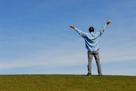 Man with arms raised up to sky Stock fotó