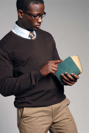 Young African American Male Reading Book Banco de Imagens - 2583972