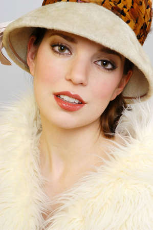 Portrait of a Beautiful Woman in Fur Hat and Fur Coat
