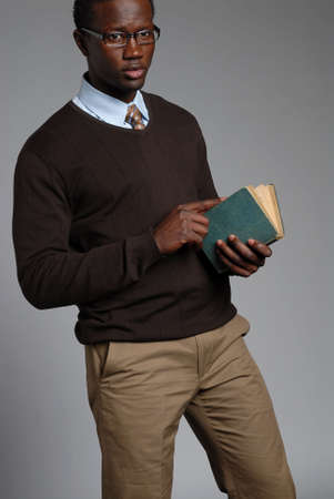 Young African American Male Holding Book Banco de Imagens