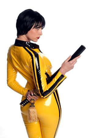Beautiful woman in yellow latex jump suit with samurai sword