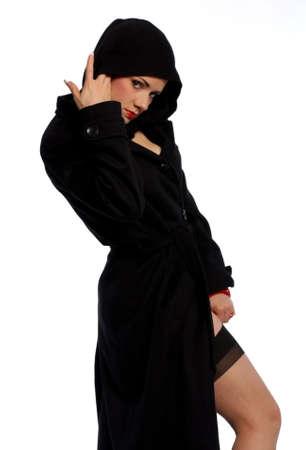 Beautiful woman in black hooded coat