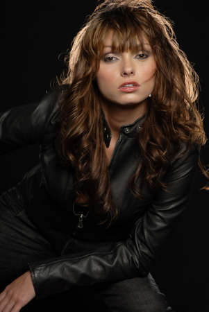 Beautiful young woman in jeans and black leather jacket