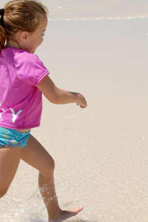 Little kid walking on beach