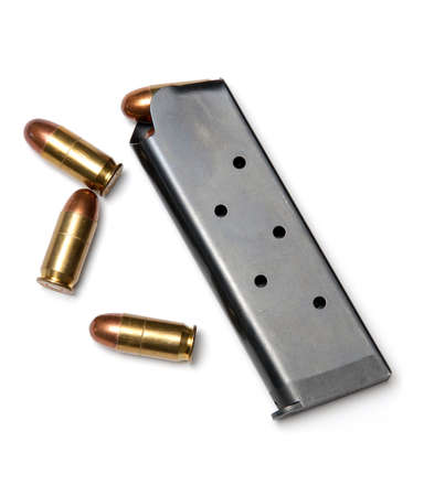 3 Bullets and loaded magazine isolated