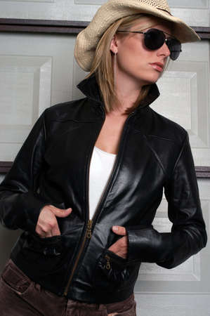 Beautiful young woman in leather jacket                 photo