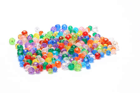 Assortment of colorful beads on white Banco de Imagens