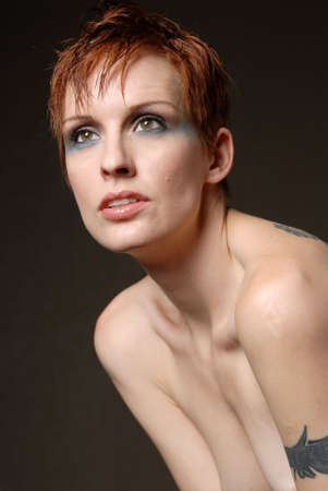 Beautiful woman with short red hair photo