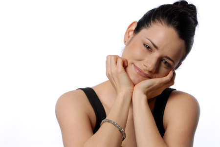 Beautiful Woman with hands on chin smiling Banco de Imagens