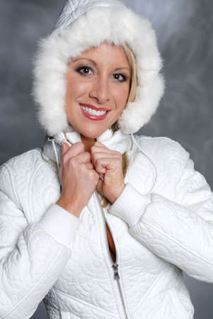 Beautiful woman smiling in white jacket with hood