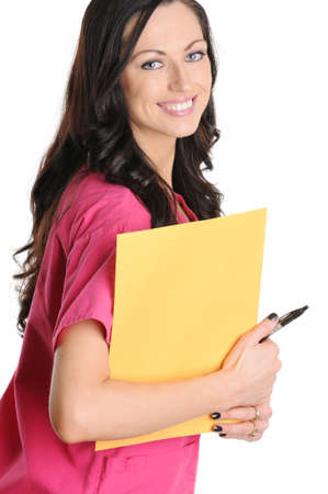 Nurse in pink scrubs holding envelope and pen