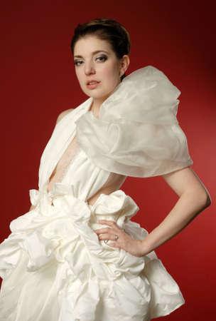 Beautiful woman in fashionable fluffy white dress