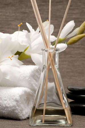 Aromatherapy diffuser, towels, stones and flower Banco de Imagens
