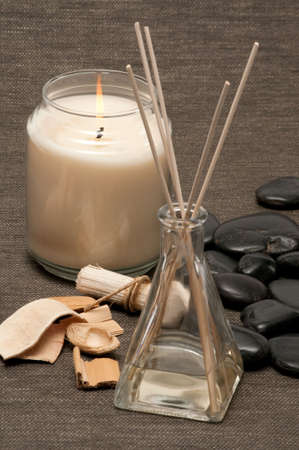 Aromatherapy diffuser, scented wood pieces, rocks and candle