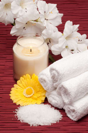 Sea salt, towels, candle, flower and yellow gerber daisy Banco de Imagens - 6772455