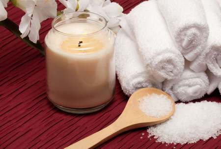 Candle, sea salt, flower and towels