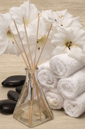 Aromatherapy diffuser towel, rocks and flower in a spa