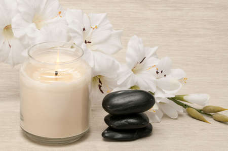 Aromatherapy spa candle, rocks and flower