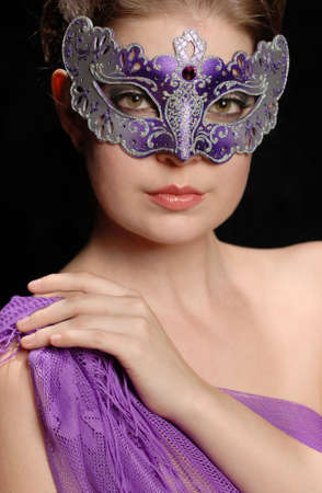 Beautiful woman in purple mask and purple top Banco de Imagens