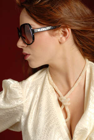 Fashionable woman with red hair wearing sunglasses Banco de Imagens - 7399722