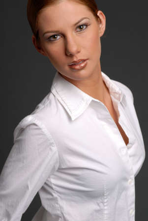 Beautiful woman in white shirt with hair pulled back photo