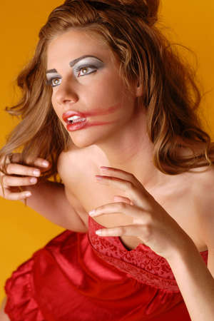 smeared: Beautiful woman with red lipstick smeared on face