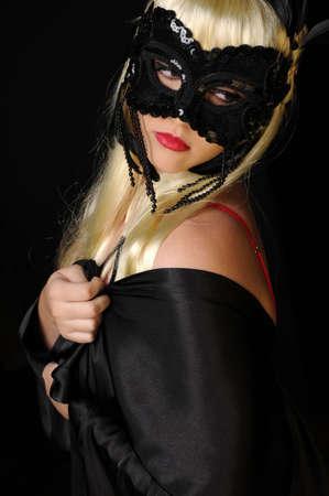 masquerade masks: Beautiful blonde women in black mask