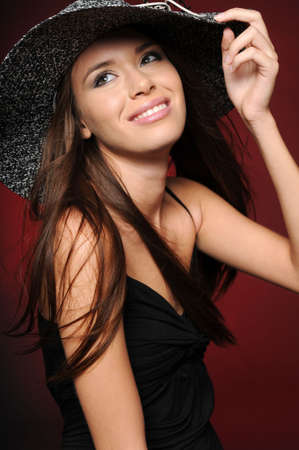 Beautiful brunette girl wearing hat smiling