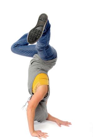 Asian woman on head upside down break dancing