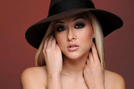 Beautiful Asian woman wearing big hat Banco de Imagens - 9637410