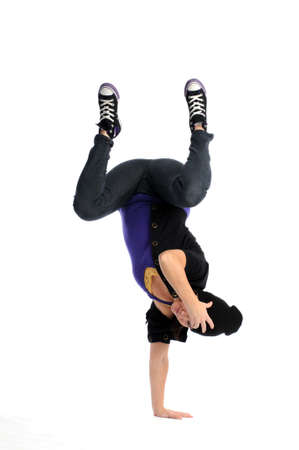Asian woman balancing on one arm upside down break dancing Banco de Imagens