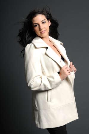Beautiful woman in white coat smiling