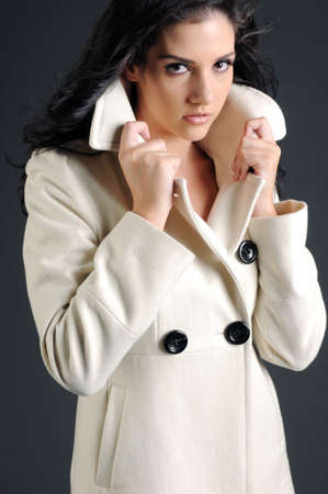 Beautiful woman in white coat holding collar Banco de Imagens