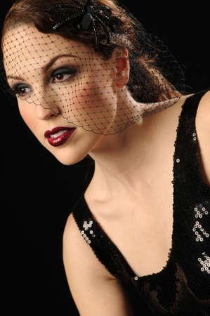 Beautiful woman in fashionable vintage head piece Banco de Imagens