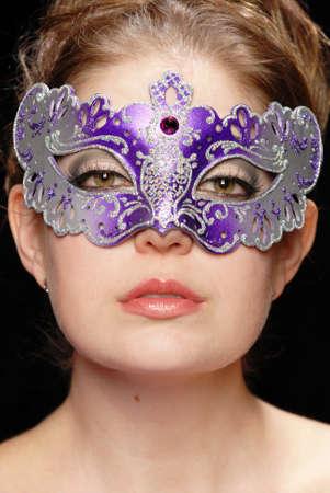 Headshot of a beautiful woman in a mask