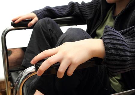 closeup of a kid in a wheel chair