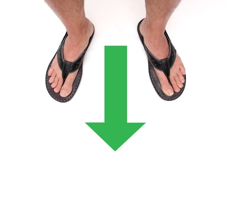 man feet with a green arrow on a white background