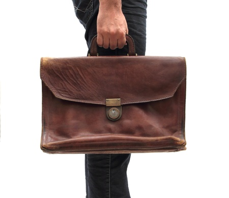 man holding an old leather bag
