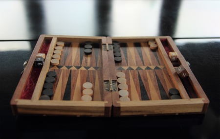old wood backgammon on a reflecting table
