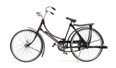 old style bycicle over white