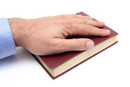 closeup of a hand swearing on a bible Stock Photo