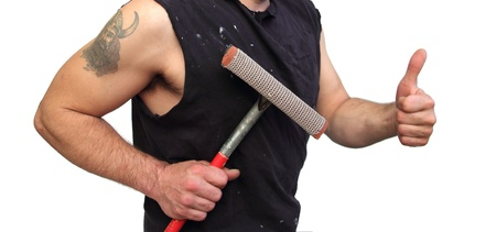 closeup of a bum with a squeegee offering his service photo