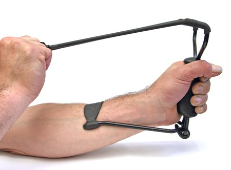 closeup of two hands using a slingshot over white photo