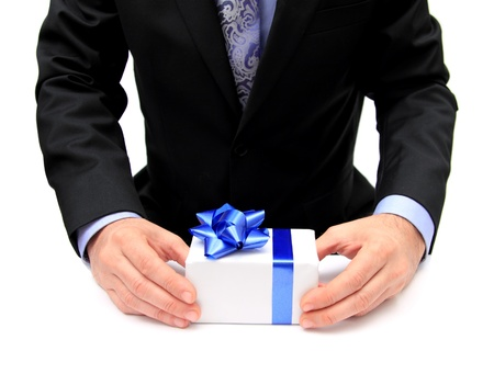 closeup of a man in a suit offering a present Standard-Bild