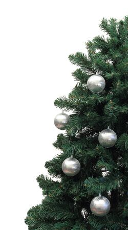 half of a christmas tree with silver balls over white Stock Photo
