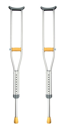 two crutches over a white background Stock Photo