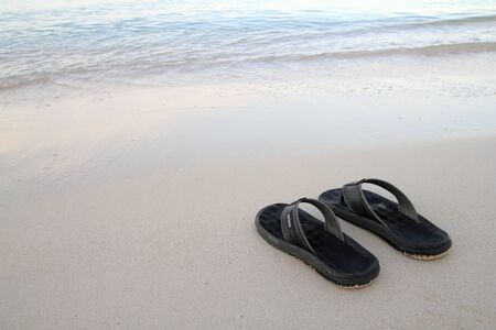flops: flip flops on the beach Stock Photo
