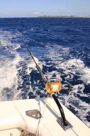 fishing rod with reel trolling on a boat photo